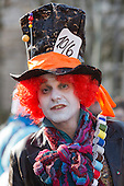 2 March 2014, Duesseldorf, Germany. Picture: man dressed as the Mad Hatter. Costumed carnival-goers enjoy the sunshine as they celebrate with a street party in Duesseldorf, North Rhine-Westphalia, Germany.