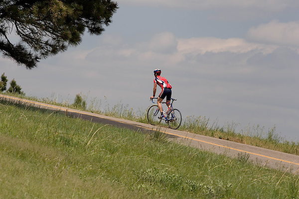Man biking up Flagstaff Mountain Road, Boulder. .  John leads private photo tours in Boulder and throughout Colorado. Year-round.