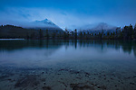 Idaho, South Central, Stanley. Pettit Lake on a stormy spring evening between rain squalls.