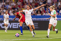LYON,  - JULY 2: Alex Morgan #13 fights for the ball with Jill Scott #8 during a game between England and USWNT at Stade de Lyon on July 2, 2019 in Lyon, France.