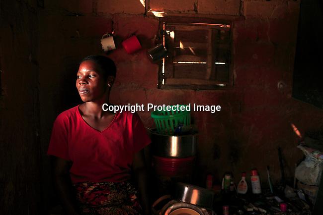 Nyota Vumiliya, age 27, in her small room in Dubie, Katanga, Congo, DRC. Photo: Per-Anders Pettersson