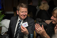 Journalist and presenter, Bill Turnbull (left), appears impressed with the magician's card trick during the Wycombe Wanderers End of Season 2016 Awards Dinner at Adams Park, High Wycombe, England on 1 May 2016. Photo by David Horn