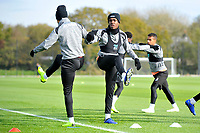 Joel Asoro (centre) of Swansea City stretches during the Swansea City Training at The Fairwood Training Ground, in Swansea, Wales, UK. Wednesday 02 November 2018
