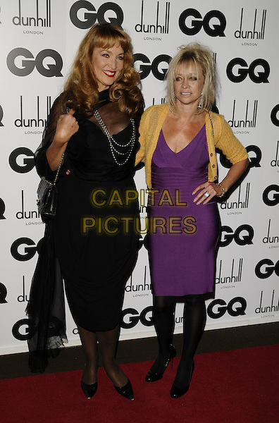 JERRY HALL & JO WOOD.Inside arrivals at the GQ Men of the Year Awards at the Royal Opera House, Covent Garden, London, England..September 2nd 2008. .full length black dress fringe bangs pearl necklace beads sheer shawl wrap purple herve leger bandage dress hand on hip yellow cardigan .CAP/CAN.©Can Nguyen/Capital Pictures.