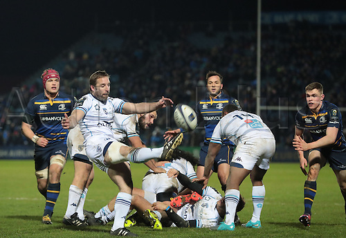 13.01.2017. RDS Arena, Dublin, Ireland. European Champions Cup Rugby. Leinster versus Montpellier.<br /> Tomas O'Leary (Montpellier) kicks clear from a ruck.