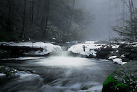 Waterfall in snow and winter ice Christmas holiday card