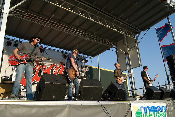 Austin, Texas based band Micky and the Motorcars (from left: Gary Braun, Micky Braun, Kris Farrow and Mark McCoy) perform during Mayfest at LaGrave Field in Fort Worth, Texas on July 12, 2009. ..The July concert was a makeup event after the original festival was canceled amid fears concerning the H1N1 (swine) influenza (Swine flu) outbreak.