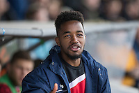 New loan signing Tariqe Fosu of Accrington Stanley takes a seat on the bench ahead of the Sky Bet League 2 match between Newport County and Accrington Stanley at Rodney Parade, Newport, Wales on 28 March 2016. Photo by Mark  Hawkins.