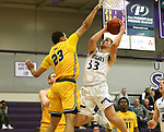 SIOUX FALLS, SD - DECEMBER 7: Aaron Rothermund #33 from the University of Sioux Falls takes the ball to the basket against Bryndan Matthews #23 from Concordia St. Paul during their game Friday night at the Stewart Center in Sioux Falls, SD. (Photo by Dave Eggen/Inertia)