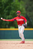 GCL Phillies second baseman Daniel Brito (21) throws to first during a game against the GCL Pirates on August 6, 2016 at Pirate City in Bradenton, Florida.  GCL Phillies defeated the GCL Pirates 4-1.  (Mike Janes/Four Seam Images)