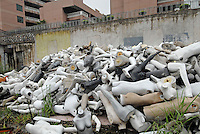 Manneqins are trashed outside the Oparchy Mannequin factory in Panyu, China. The process of mannequin manufacturing involves the use of toxic cancer causing resin and the use of fibre glass that creates a poisonous dust. The workers are paid higher wages to work in such conditions..13 Jun 2007