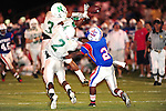 Two Newman defenders combine to break up a pass on 4th down during early action between Newman and John Curtis.<br /> Curtis went on to win the game by a score of 34-7.