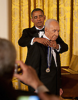 United States President Barack Obama awards the Presidential Medal of Freedom to President Shimon Peres of Israel during a dinner in his honor in the East Room of the White House in Washington, D.C. on Wednesday, June 13, 2012..Credit: Martin Simon / Pool via CNP /MediaPunch