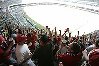 United States Men's National team fans celebrate the USA's goal in the first half at Azteca stadium. The United States Men's National Team played Mexico in a CONCACAF World Cup Qualifier match at Azteca Stadium in, Mexico City, Mexico on Wednesday, August 12, 2009.