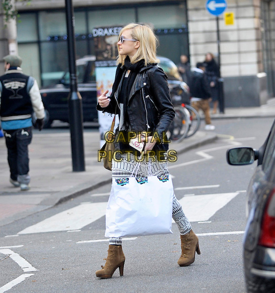 Fearne Cotton spotted in London, London, England..December 14th, 2011.full length beige ankle boots buckles black white print trousers leather jacket scarf sunglasses shades shopping bag purse side profile .CAP/DYL.©Dylan/Capital Pictures.