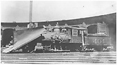 3/4 fireman's-side view of D&amp;RG #404 with large wedge pilot snowplow in front of Salida roundhouse.<br /> D&amp;RG  Salida, CO