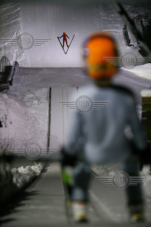 Jens Schøien Øvregård (11) waiting at the top of the   K39 ski jump in Linderudkollen, during training.