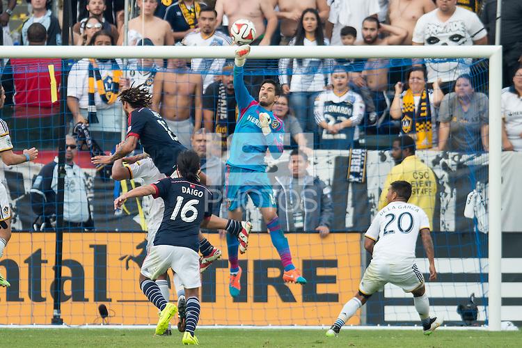 CARSON, CA - December 7, 2014: LA Galaxy goalie Jaime Penedo (18) makes a save during the game, The MLS Cup. LA Galaxy vs New England Revolution match at the StubHub Center in Carson, California. Final score, LA Galaxy 2, New England Revolution 1 (2 OT).