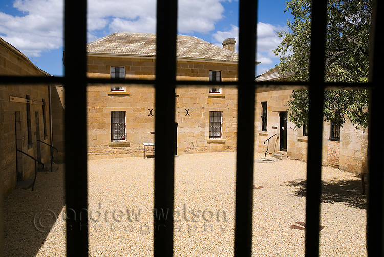 Looking through prison bars at Richmond Gaol.  Built in 1825 as part of Governor Arthur's system of police districts, it was used as a gaol until 1928.   Richmond, Tasmania, Australia