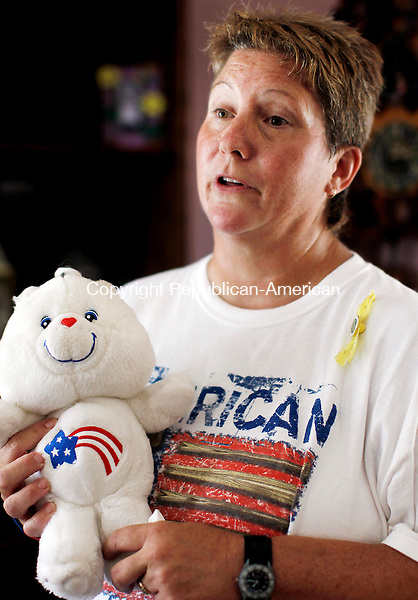 Waterbury, CT- 04, August 2010-080410CM08  Lori Stroud holds a patriotic Care Bear, the same one her daughter, Jess Stroud, who is a Sergeant in the Army Reserves stationed in Iraq also has.  To keep close to her daughter, Stroud has decorated her house in american flags and other patriotic crafts.    --Christopher Massa Republican-American