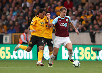 Burnley's James Tarkowski and Wolverhampton Wanderers' Helder Costa<br /> <br /> <br /> Photographer Rachel Holborn/CameraSport<br /> <br /> The Premier League - Wolverhampton Wanderers v Burnley - Sunday 16th September 2018 - Molineux - Wolverhampton<br /> <br /> World Copyright &copy; 2018 CameraSport. All rights reserved. 43 Linden Ave. Countesthorpe. Leicester. England. LE8 5PG - Tel: +44 (0) 116 277 4147 - admin@camerasport.com - www.camerasport.com