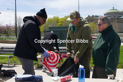 Saturday, April 22nd, 2017 was Earth Day and the Jackson Park Advisory Council stepped up with various projects around the neighborhood.<br /> <br /> 2591 &ndash; Jackson Park Advisory Council volunteers help clear garbage from the 57th Street Beach.<br /> <br /> Please 'Like' &quot;Spencer Bibbs Photography&quot; on Facebook.<br /> <br /> All rights to this photo are owned by Spencer Bibbs of Spencer Bibbs Photography and may only be used in any way shape or form, whole or in part with written permission by the owner of the photo, Spencer Bibbs.<br /> <br /> For all of your photography needs, please contact Spencer Bibbs at 773-895-4744. I can also be reached in the following ways:<br /> <br /> Website &ndash; www.spbdigitalconcepts.photoshelter.com<br /> <br /> Text - Text &ldquo;Spencer Bibbs&rdquo; to 72727<br /> <br /> Email &ndash; spencerbibbsphotography@yahoo.com