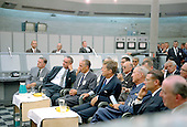 A briefing is given by Major Rocco Petrone to United States President John F. Kennedy during a tour of Blockhouse 34 at the Cape Canaveral Missile Test Annex, Cape Canaveral, Florida on September 11, 1962.  Also visible in the photo, from left, National Aeronautics and Space Administration Administrator James Webb, United States Vice President Lyndon B. Johnson,  Doctor Kurt Debus, President Kennedy, unidentified, United States Secretary of Defense Robert McNamara, and unidentified..Credit: NASA via CNP