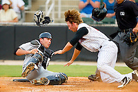Ross Wilson #17 of the Kannapolis Intimidators collides with Hagerstown Suns catcher Sam Palace #8 at home plate at CMC-Northeast Stadium on June 9, 2012 in Kannapolis, North Carolina.  The Suns defeated the Intimidators 11-6.  (Brian Westerholt/Four Seam Images)
