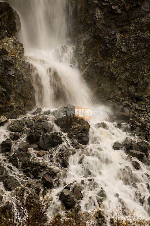 Close-up of a waterfall into a stream.