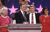 United States Vice President George H.W. Bush, left center, and U.S. Senator Dan Quayle (Republican of Indiana), right center, on the podium after delivering their speeches accepting their party's nomination for President and Vice President of the United States respectively at the 1988 Republican Convention at the Super Dome in New Orleans, Louisiana on August 18, 1988.  With them are their wives, Barbara Bush, left, and Marilyn Quayle, right.<br /> Credit: Arnie Sachs / CNP
