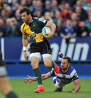 Ben Foden counter-attacks as Micky Young looks to tap-tackle him. Amlin Challenge Cup Final, between Bath Rugby and Northampton Saints on May 23, 2014 at the Cardiff Arms Park in Cardiff, Wales. Photo by: Patrick Khachfe / Onside Images