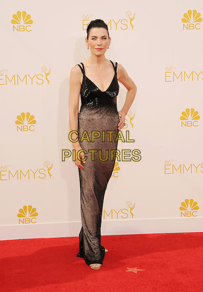 LOS ANGELES, CA- AUGUST 25: Actress Julianna Margulies arrives at the 66th Annual Primetime Emmy Awards at Nokia Theatre L.A. Live on August 25, 2014 in Los Angeles, California.<br /> CAP/ROT/TM<br /> &copy;Tony Michaels/Roth Stock/Capital Pictures