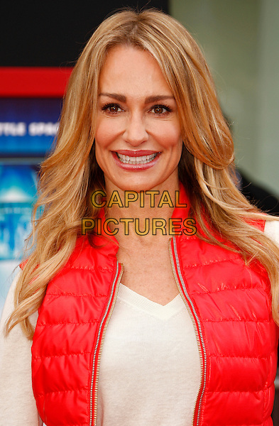 TAYLOR ARMSTRONG.World Premiere of 'Mars Needs Moms'.El Capitan Theatre, Los Angeles, California, USA..March 6th, 2011 .headshot portrait white beige red puffa sleeveless vest top.CAP/PE.©Peter Eden/Capital Pictures.