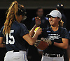 Skyler Cirillo of Lindenhurst #5, right, gets congratulated by pitcher Allie Stanya of Babylon #15 after making a running catch from second base in the bottom of the seventh inning of the Long Island Senior All-Star softball game at Hofstra University on Tuesday, June 5, 2018.