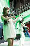Jan 15, 2010 - Chiba, Japan - A violinist plays on Honda booth during the Tokyo Auto Salon 2010 in Chiba, suburb Tokyo, on January 15, 2010. More than 400 companies, associations and groups are displaying more than 600 custom vehicules in the Japan's biggest tuning show which takes place between January 15 and 17. (Photo Laurent Benchana/Nippon News).