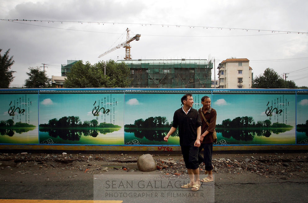 Billboards depict idyllic wetlands in the town of Dujiangyan, Sichuan Province. The town is still rebuilding after being severely damaged during the 2008 earthquake. 2010