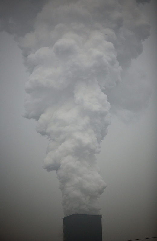 Smoke and ash are belched in to the air from a smokestack at a coal coking plant in Linfen, China.