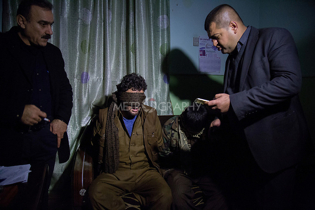 5/1/2016--Iraq,Kirkuk-- One of the security sergeant is interrogating the kidnapper for finding more new information about all the group members.