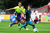 Bersant Celina of Swansea City vies for possession with Gary Warren of Exeter City during the pre season friendly match between Exeter City and Swansea City at St James Park in Exeter, England, UK. Saturday, 20 July 2019