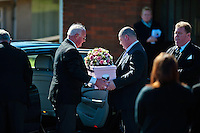 Tuesday 11 March 2014<br /> Pictured: Dad Patrick Mullane (R) helps carry the tiny coffin from the car <br /> Re: A funeral is taking place  in Pontyberem Catholic Church for six day old Eliza-Mae Mullane who died after an incident at the family home in Carmarthenshire in the morning of 18 February 2014, where police later seized two dogs, an Alaskan Malamute called Nisha and a collie cross that were destroyed following the baby girl's death.<br /> Parents Sharon John and Patrick Mullane said previously that they would cherish the short time they had with her.