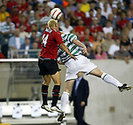 28 July 2004: Alan Smith (14) and Jops Valgaeren (5) challenge for a header in the first half. Glasgow Celtic of the Scottish Premier League defeated Manchester United of the English Premier League 2-1 at Lincoln Financial Field in Philadelphia, PA in a ChampionsWorld Series friendly match..