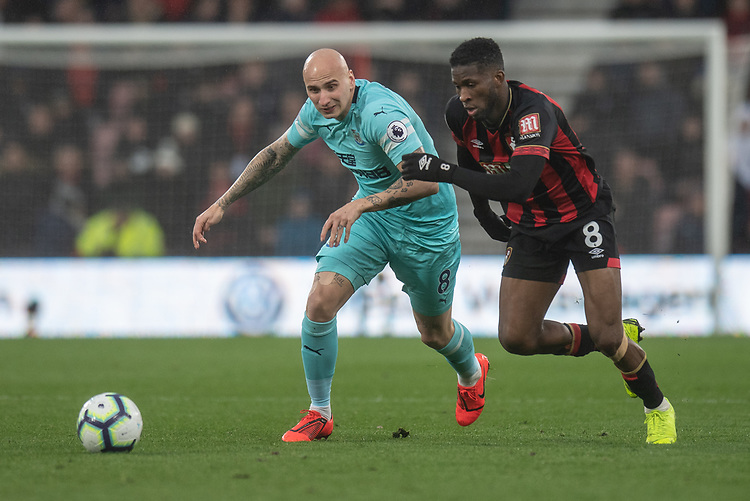 Bournemouth's Jefferson Lerma (right) vies for possession with Newcastle United's Jonjo Shelvey (left) <br /> <br /> Photographer David Horton/CameraSport<br /> <br /> The Premier League - Bournemouth v Newcastle United - Saturday 16th March 2019 - Vitality Stadium - Bournemouth<br /> <br /> World Copyright © 2019 CameraSport. All rights reserved. 43 Linden Ave. Countesthorpe. Leicester. England. LE8 5PG - Tel: +44 (0) 116 277 4147 - admin@camerasport.com - www.camerasport.com