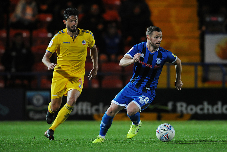 Rochdale's Jimmy Ryan under pressure from Bolton Wanderers' Jason Lowe<br /> <br /> Photographer Kevin Barnes/CameraSport<br /> <br /> EFL Leasing.com Trophy - Northern Section - Group F - Rochdale v Bolton Wanderers - Tuesday 1st October 2019  - University of Bolton Stadium - Bolton<br />  <br /> World Copyright © 2018 CameraSport. All rights reserved. 43 Linden Ave. Countesthorpe. Leicester. England. LE8 5PG - Tel: +44 (0) 116 277 4147 - admin@camerasport.com - www.camerasport.com