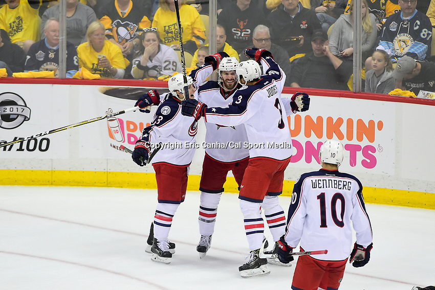 Thursday, April 20, 2017: Columbus Blue Jackets center Boone Jenner (38) (center) celebrates a goal with defenseman Seth Jones (3) and right wing Cam Atkinson (13) during game 5 of round one of the National Hockey League Eastern Conference Stanley Cup Playoffs between the Columbus Blue Jackets and the Pittsburgh Penguins, held at PPG Paints Arena, in Pittsburgh, PA. Pittsburgh defeats Columbus 5-2 to win the best of seven series 4 games to 1and advances to round two of the Eastern Conference Playoffs. Eric Canha/CSM