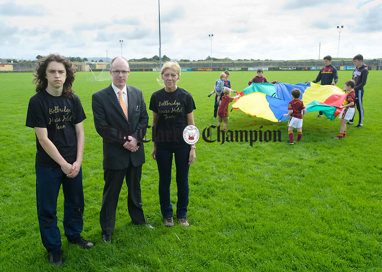 Liam O Halloran Bryant of Miltown Malbay who is doing a skydive in aid of the underage footballers in St Joseph's GAA Miltown, as well as raising awareness of autism, with his sponsor David Mc Manus of The Bellbridge House Hotel, his mother Pauline and club players. Photograph by John Kelly.