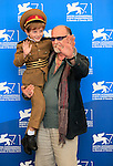 """Young actor Dachi Orvelashvili poses with actor Misha Gomiashvili during a photocall of the movie """"The President"""" presented in the """"Orizzonti"""" selection at the 71st Venice Film Festival on August 27, 2014 at Venice Lido."""