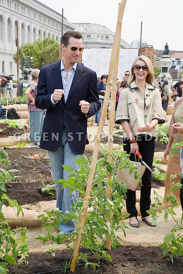 "San Francisco Mayor Gavin Newsom, and Jennifer Siebel, fiancee, at Community Planting Day (July 12, 2008) of the Slow Food Nation Victory Garden at San Francisco's Civic Center. The garden project ""demonstrates the potential of a truly local agriculture practice that unites and promotes Bay Area urban gardening organizations, while producing high quality food for those in need.""* The garden is planted on the same site as the post-World War II garden sixty years ago. The food will be grown over a period of two months, harvested, and donated to people in need..*slowfoodnation.org"