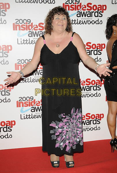 CHERYL FERGISON.The Inside Soap Awards 2009, Sketch, London, England. .September 28th, 2009 .full length black maxi dress pink floral print ferguson hands .CAP/CAN.©Can Nguyen/Capital Pictures.