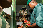 Anti-poaching scout receiving bullets before deployment, Kafue National Park, Zambia