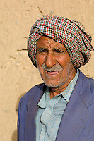 An old man with a friendly face photographed near the Zoroastrian Towers of Silence at Yazd in Iran.